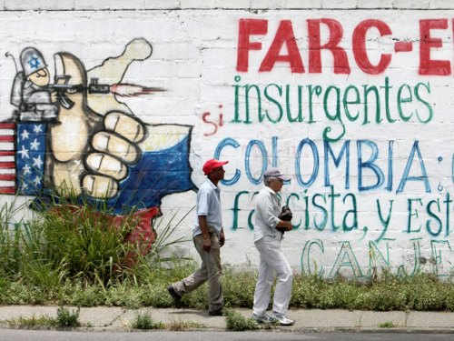 A sign in Caracas, Venezuela, denounces the Colombian government's decision to allow the U.S. military to use some of its bases. Colombia has accused Venezuela of supporting anti-government rebels, known as the FARC. Thomas Coex/AFP/Getty Images