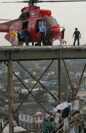 Workers move patients up the stairs from the parking garage to the helipad to be evacuated from Memorial Medical Center in New Orleans on Sept. 1, 2005. (Brad Loper/Dallas Morning News/Corbis)