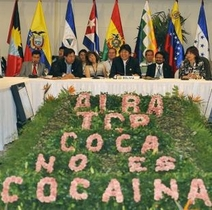 """Bolivian President, Evo Morales (C), heads the VII Summit of the Bolivarian Alliance for the Americas (ALBA) trade bloc above a sign reading """"ALBA TCP, Coca is not cocaine."""" Leftist Latin American leaders agreed on the creation of a regional currency, the Sucre, aimed at scaling back the use of the US dollar."""