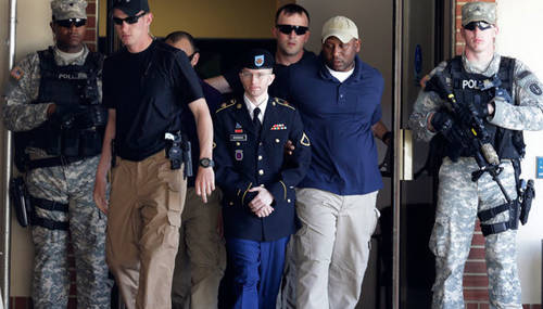 U.S. Army Private First Class Bradley Manning (3rd L) departs after day two of his court-martial at Fort Meade, Maryland June 4, 2013.(Reuters / Gary Cameron)